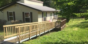 Wooden wheelchair ramp by Richmond Ramps
